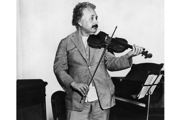 Albert Einstein playing the violin, c1931. (Photo by Keystone/Getty Images)