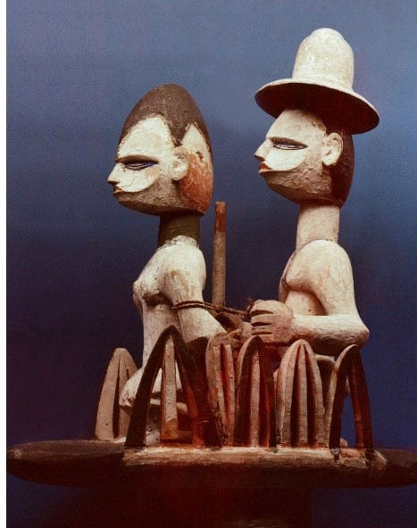 Wooden dance headdress showing a slave trader, wearing a European hat, with his woman captive, Nigeria. Igbo. 20th c . (Photo by Werner Forman/Universal Images Group/Getty Images)
