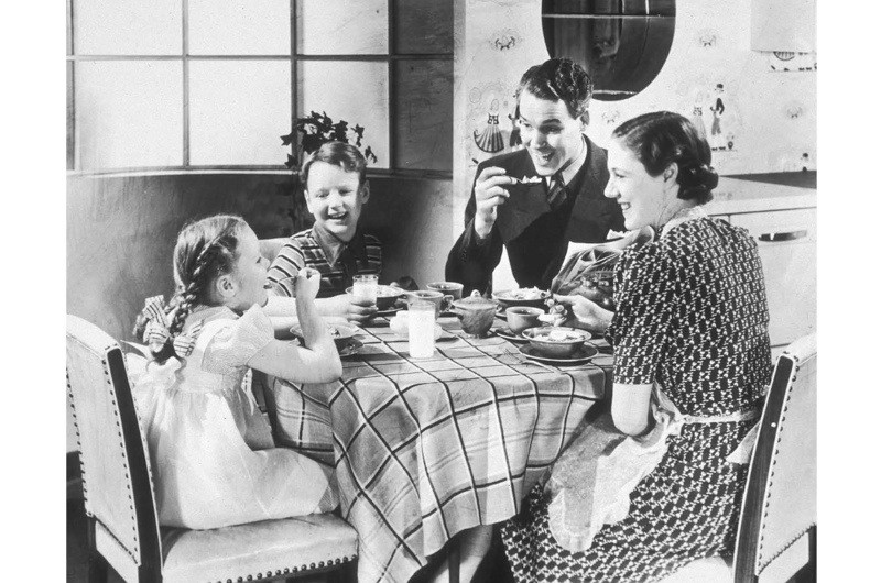 c1935-A-happy-family-of-four-sits-at-their-kitchen-table-while-eating-breakfast.jpg-685919d