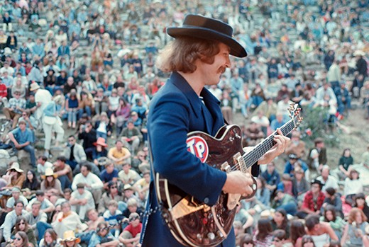 ca. June 1967, Mount Tamalpais State Park, California, USA --- Guitarist David Crosby of the Byrds performs with his band in front of a large crowd at the Magic Mountain Music Festival on Mount Tamalpais. --- Image by © Henry Diltz/Corbis
