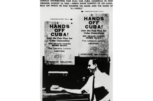 Warren Commission exhibit. Lee Harvey Oswald distributing Fair Play for Cuba handbills on which he had stamped his name and the name AJ Hidell. (Photo by CSU Archives/Everett Collection)