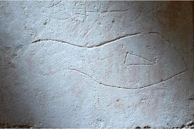 Graffiti footprints and handprints found at churches