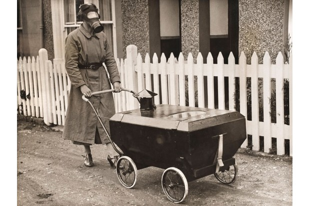 A woman using the gas-resistant pram. (Credit: © Chronicle / Alamy)
