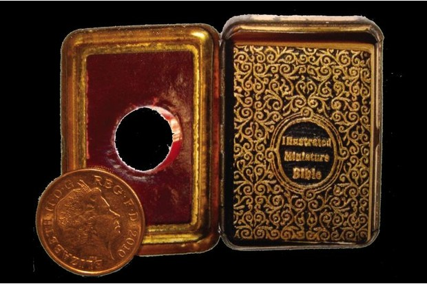 illustrated miniature Bible with penny