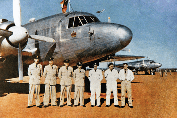 An unofficial but rare colour image from the 1947 Royal tour to South Africa showing both the flight and ground crew of the King's personal Viking, VL246. Left to right are: Flt Lt Reid (Radio Officer); Flt Lt Fowkes (Navigator); Flt Lt Lee (2nd Pilot); Wg Comm Tacon (CO and Pilot); Cpl Reynolds (Engines); Cpl Bulled (Airframe); and LAC Elliot (Steward). (Queen's Flight Archive A846)