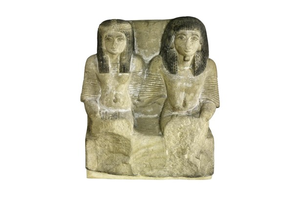 Sandstone pair statue of the chief of police and his wife