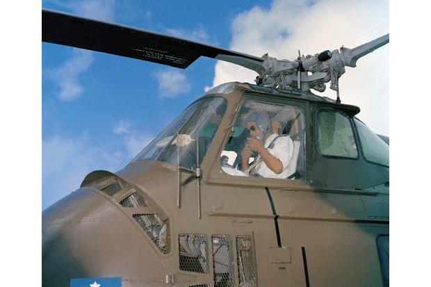 The Duke of Edinburgh in the cockpit of a Whirlwind helicopter during his visit to Christmas Island in April 1959. (Crown Copyright/Air Historical Branch image T-916)