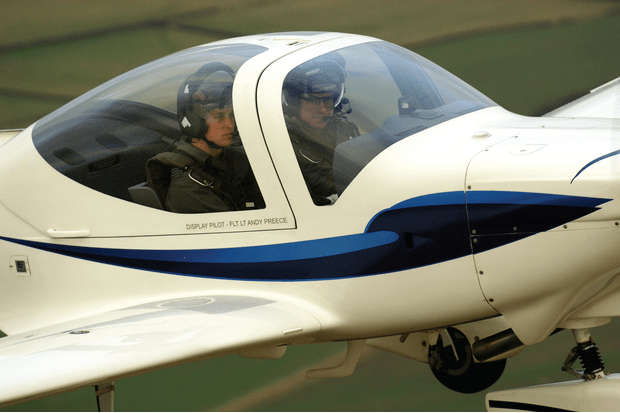HRH Prince William underwent basic flying tuition in the Grob Tutor T.1 with No. 1 Elementary Flying Training School at RAF Cranwell. He was photographed at the controls, in company with his instructor, on 14 January 2008. (Crown Copyright/Air Historical Branch image CCT-08-004-0020/Cpl Scott Robertson)