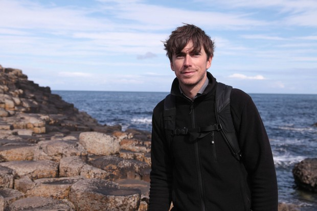 Programme Name: Ireland with Simon Reeve - TX: n/a - Episode: n/a (No. 2) - Picture Shows: at Giant's Causeway. Simon Reeve - (C) BBC - Photographer: Ruth Mayer