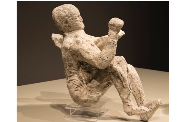 A plaster cast body of a person killed by the eruption of Mount Vesuvius at Pompeii in AD 79, on display at the Royal Ontario Museum. (Photo by Roberto Machado Noa/LightRocket via Getty Images)
