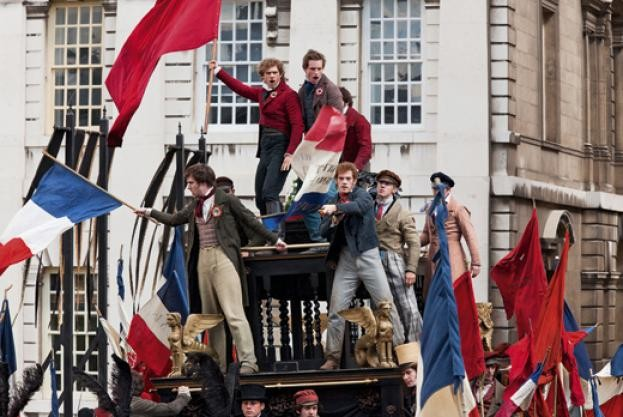 Parisians man the barricades in the 2012 film production of the Victor Hugo classic Les Misérables, a work inspired by the June Rebellion of 1832. (Rex)