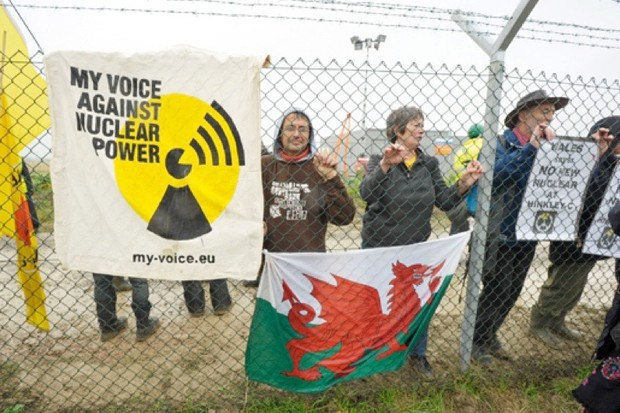 Protesters behind the perimeter fence at Hinkley Point Nuclear Power Station. (Photo by London News Pictures/REX)