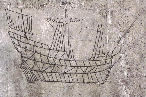 A carving of a ship as graffiti