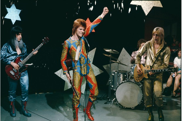 Editorial Use Only. No merchandising Mandatory Credit: Photo by REX/Shutterstock (6318843p) David Bowie performing as Ziggy Stardust, with Trevor Bolder and Mick Ronson, on Granada TV series 'Lift Off' - c 1972 'Lift Off' TV Series - 1972