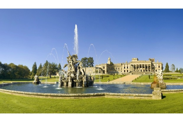 Photograph of Witley Court taken from behind a fountain situated in the grounds.