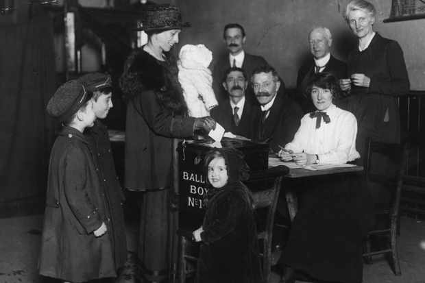 A woman votes for the first time in 1918 Britain