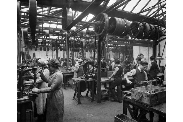 Women and boys work a brass-finishing workshop in Westminster, London, during the First World War