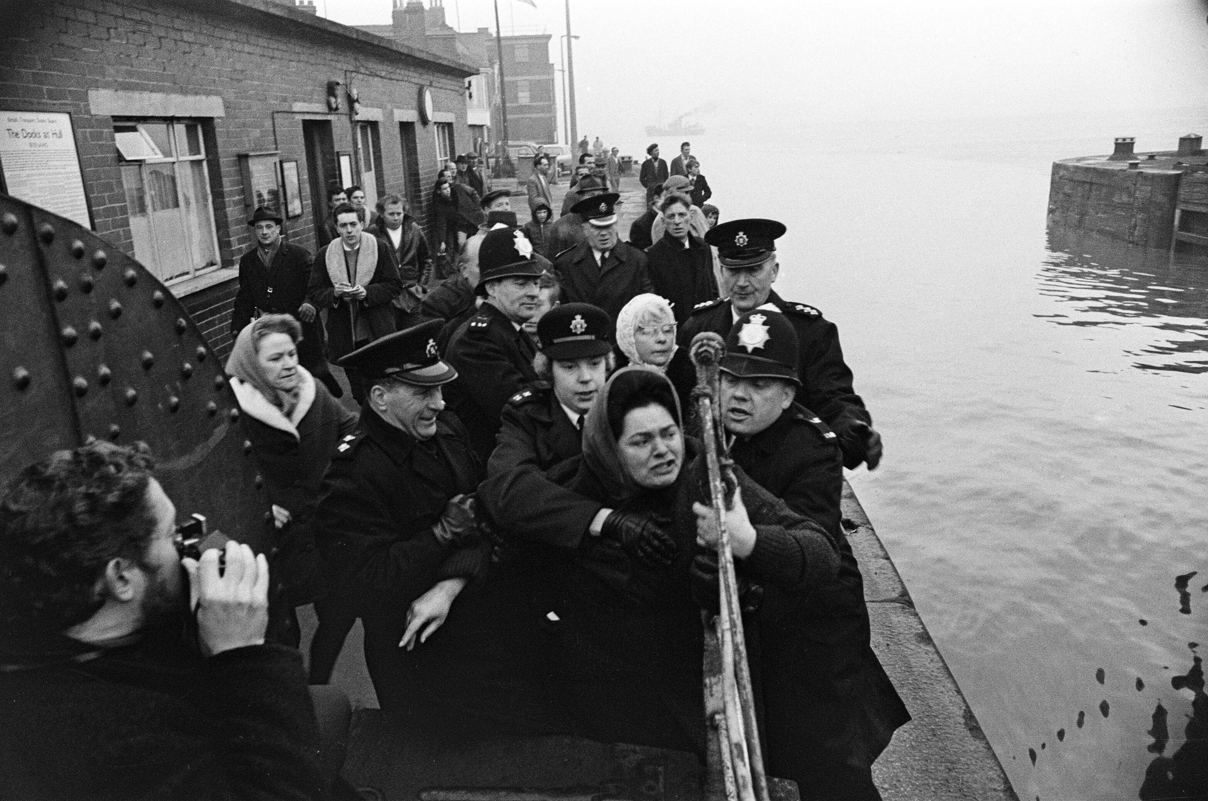 Police hold back Mrs Lillian Bilocca on the quayside at Hull