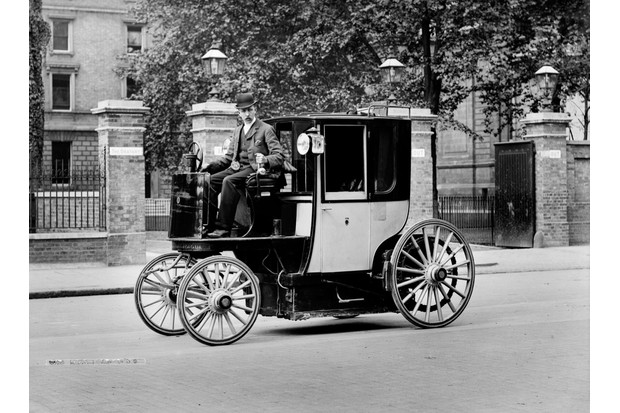 An electric motor cab and driver, London, c1897