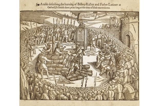 "Descriptive table of the execution of Bishop Nicholas Ridley (1500-1555) and Father Hugh Latimer (1487-1555) preacher, reformer, condemned by Mary Tudor to die at the stake at Balliol College, Oxford, October 16, 1555. In the picture, the bishop-martyr and the preacher in the pulpit speak in Latin, the priest martyr, L. Willias and the Archbishop of Canterbury Thomas Cranmer (1489-1556) are expressing themselves in English. Engraving from the ""Book of Martyrs"" by John Foxe, London 1563. (Photo by Fototeca Gilardi/Getty Images)."
