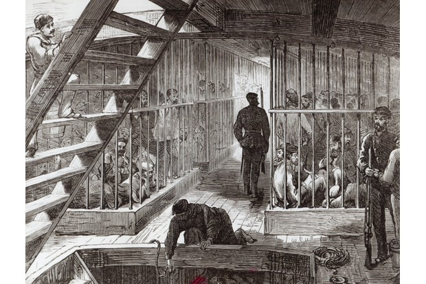 Convicts are shown in cages on a ship of the First Fleet, which in 1787 sailed to New South Wales, where prisoners faced more harsh conditions. (Image by Bridgeman)