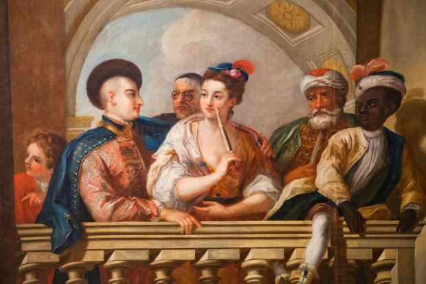 This painting in Kensington Palace shows a group standing on a balustrade. Among them are George I's two Turkish grooms of the chamber, 'Mustapha' and 'Mohamed'. (Photo by Steve Vidler/Alamy Stock Photo)