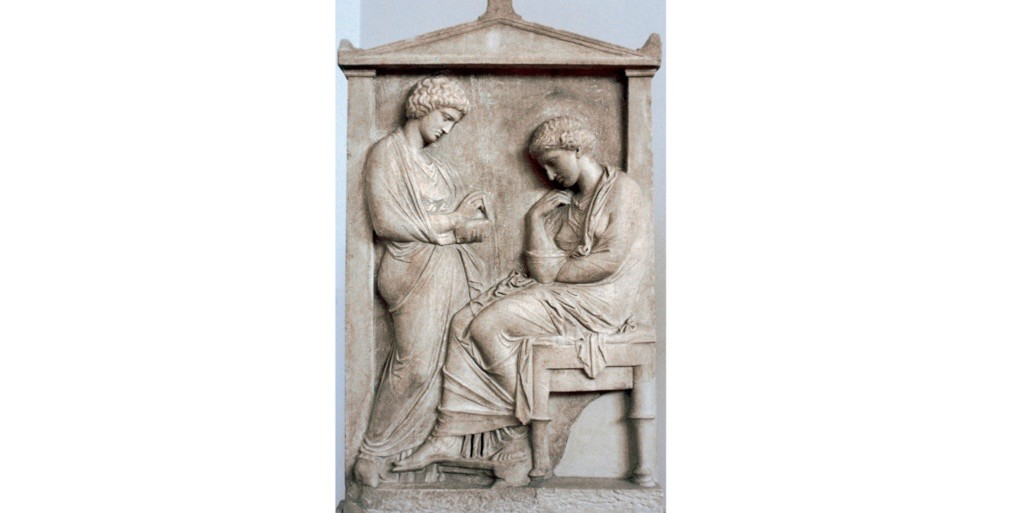 A Greek relief depicting a woman sitting with her jewels with a slave. (Photo by PHAS/UIG via Getty Images)