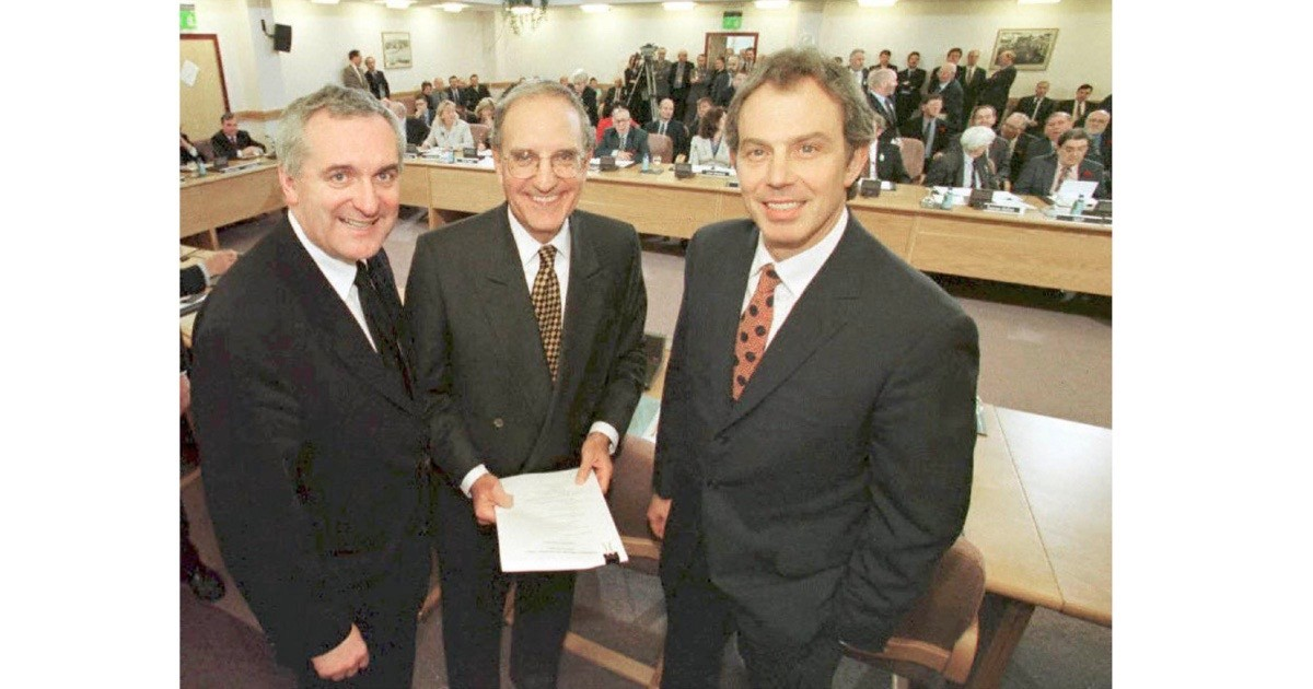 British prime minister Tony Blair (right), US Senator George Mitchell (centre) and Irish prime minister Bertie Ahern smiling on 10 April 1998 after signing the Good Friday Agreement – an historic agreement for peace in Northern Ireland. (Photo by Dan Chung/AFP/Getty Images)