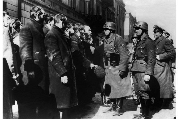 A group of Polish Jews from the Warsaw Ghetto being interrogated by Nazi officers. The suffering in the ghetto was extreme, and anyone caught trying to leave was shot, says Alexandra Richie. (Photo by Keystone-France/Gamma-Keystone via Getty Images)