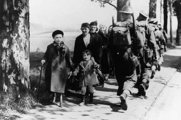 A group of Belgian refugees fleeing upon the arrival of German troops on the roads, 21 June 1940. (Photo by Keystone-France/Gamma-Keystone via Getty Images)