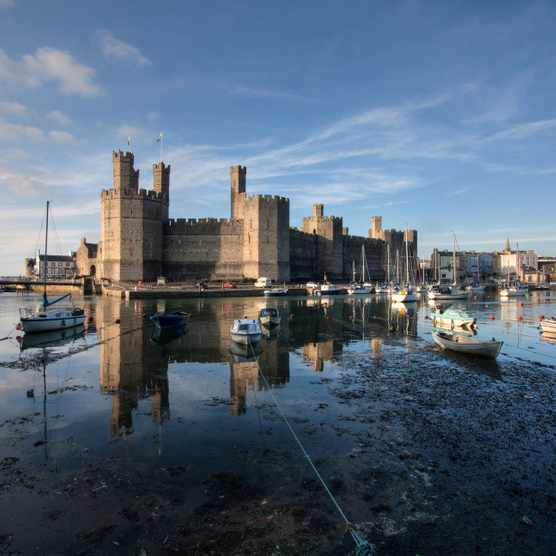 The distinctive polygon towers of Caernarfon Castle. (Photo by Gail Johnson/Getty Images)