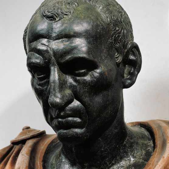 UNSPECIFIED - CIRCA 1999:  Roman civilization, 1st century b.C. Bronze head with marble bust of Julius Caesar, 100-44 b.C. Detail, face.  (Photo By DEA PICTURE LIBRARY/De Agostini/Getty Images)