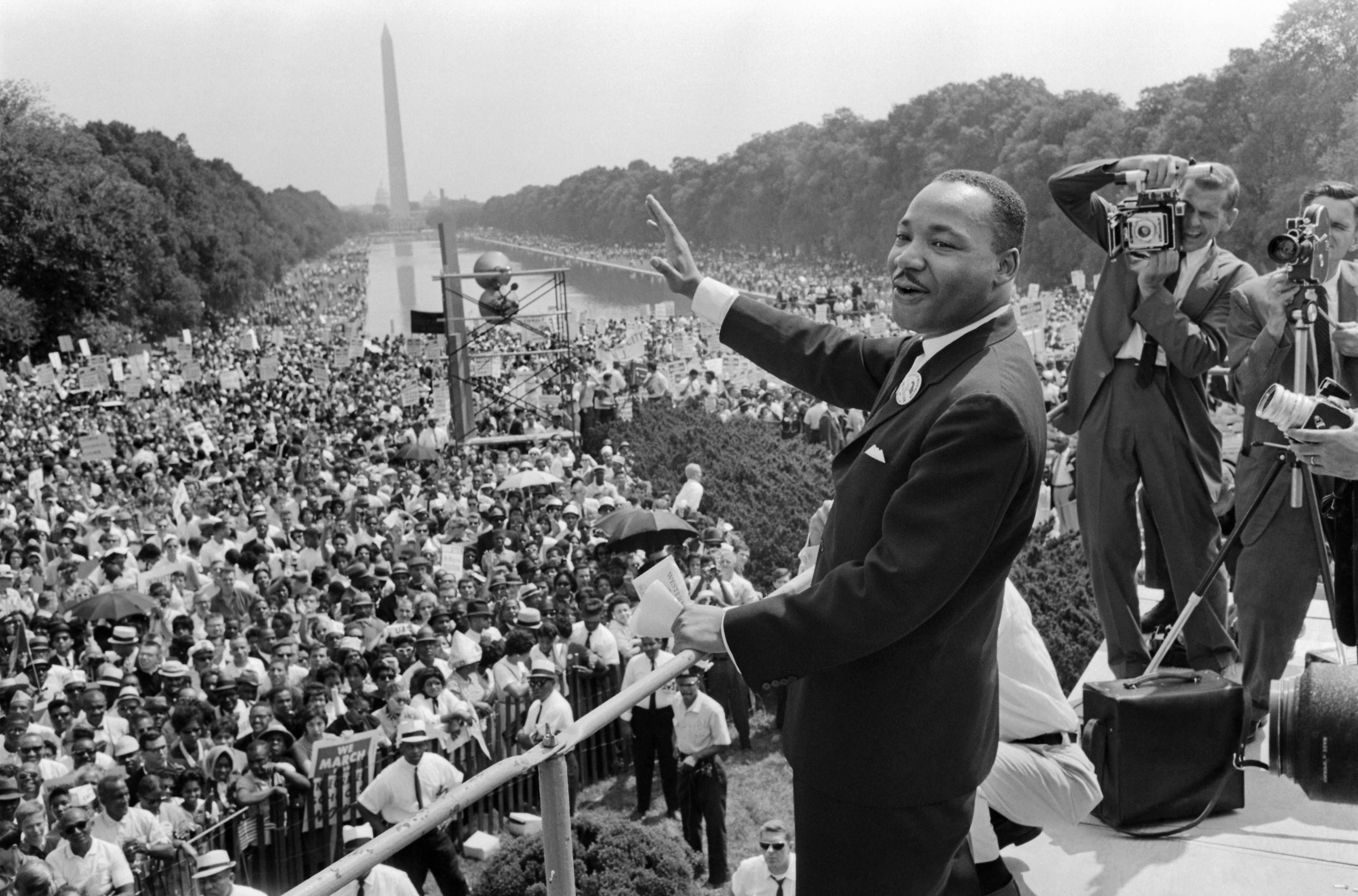 Martin Luther King waves to supporters on the Mall in Washington DC during the March on Washington, 28 August 1963. (Photo by AFP/Getty Images)