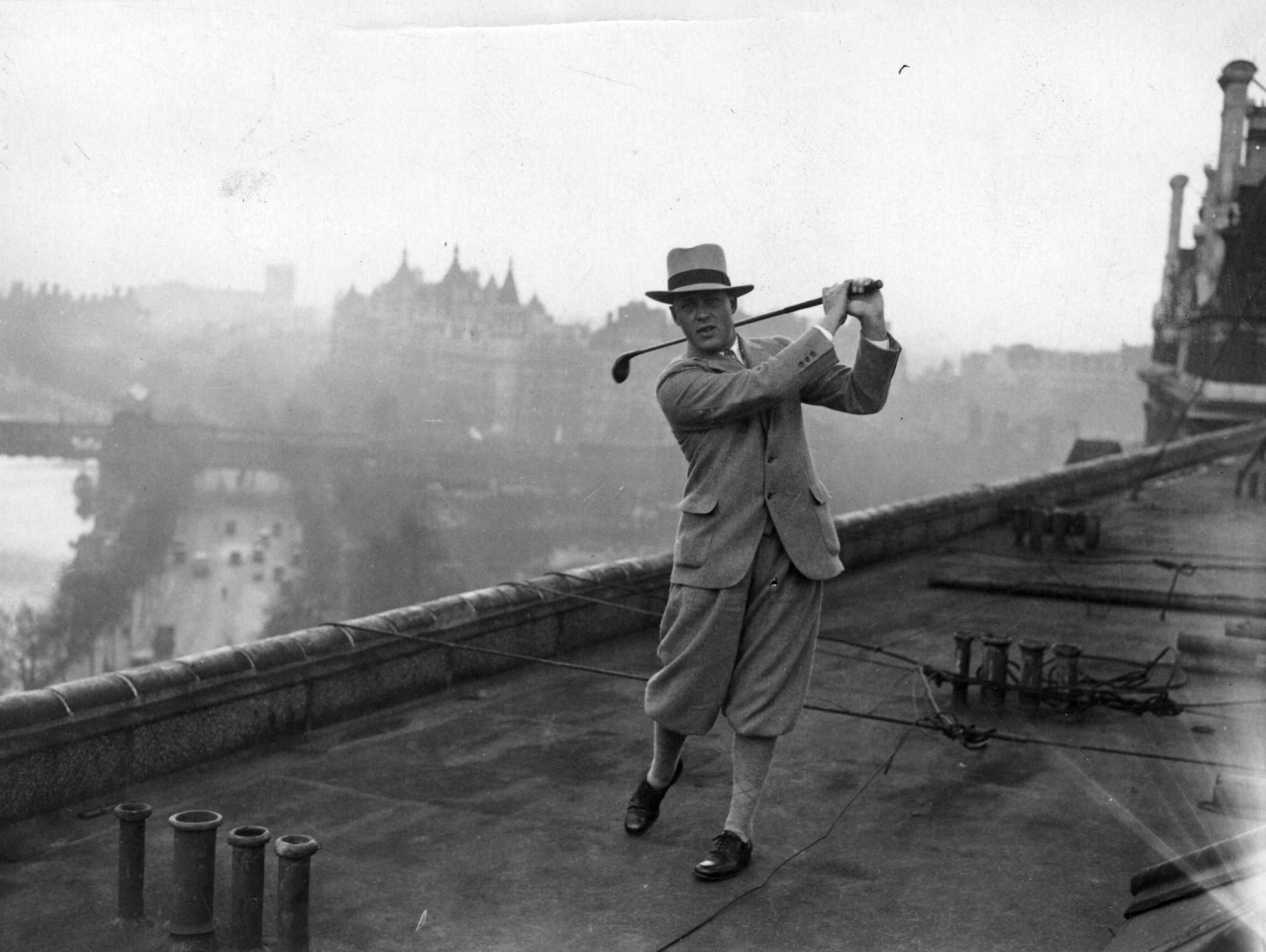 American golfer Bobby Jones practising his swing on the roof of the Savoy Hotel in London. (Photo by Topical Press Agency/Getty Images)
