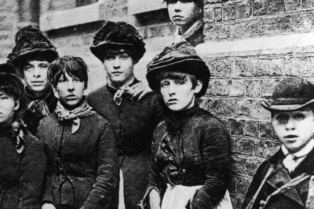 A black and white photo of several 'matchwomen', who went on strike at the Bryant and May's factory in London in 1888.