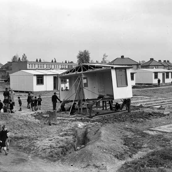Schoolchildren helping workmen construct a new estate of pre-fabricated houses in Watford, Hertfordshire in 1946 following the devastation of the Second World War. (Photo by Keystone Features/Getty Images)