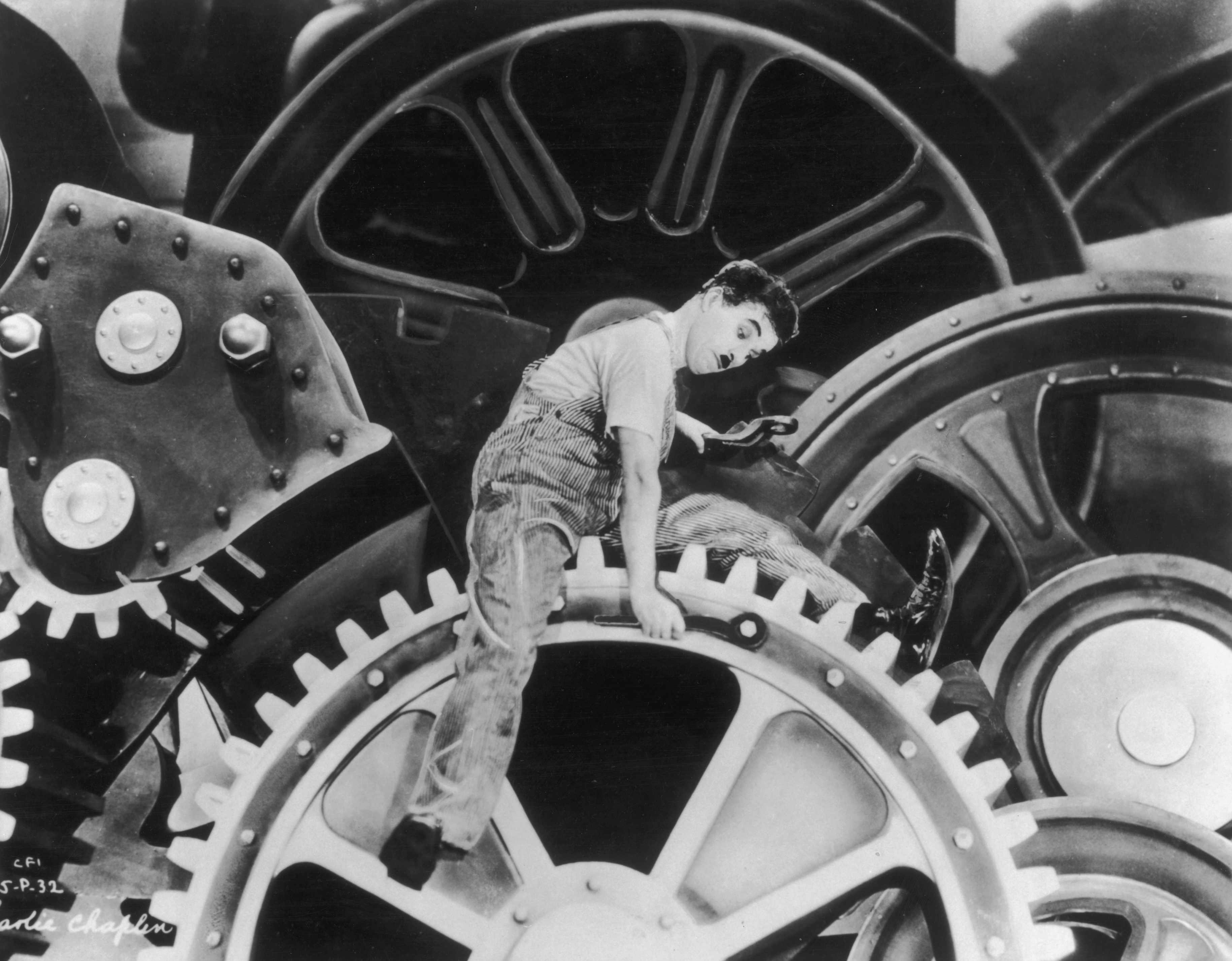 Charlie Chaplin, in a still from his 1936 film 'Modern Times'. (Photo by American Stock/Getty Images)