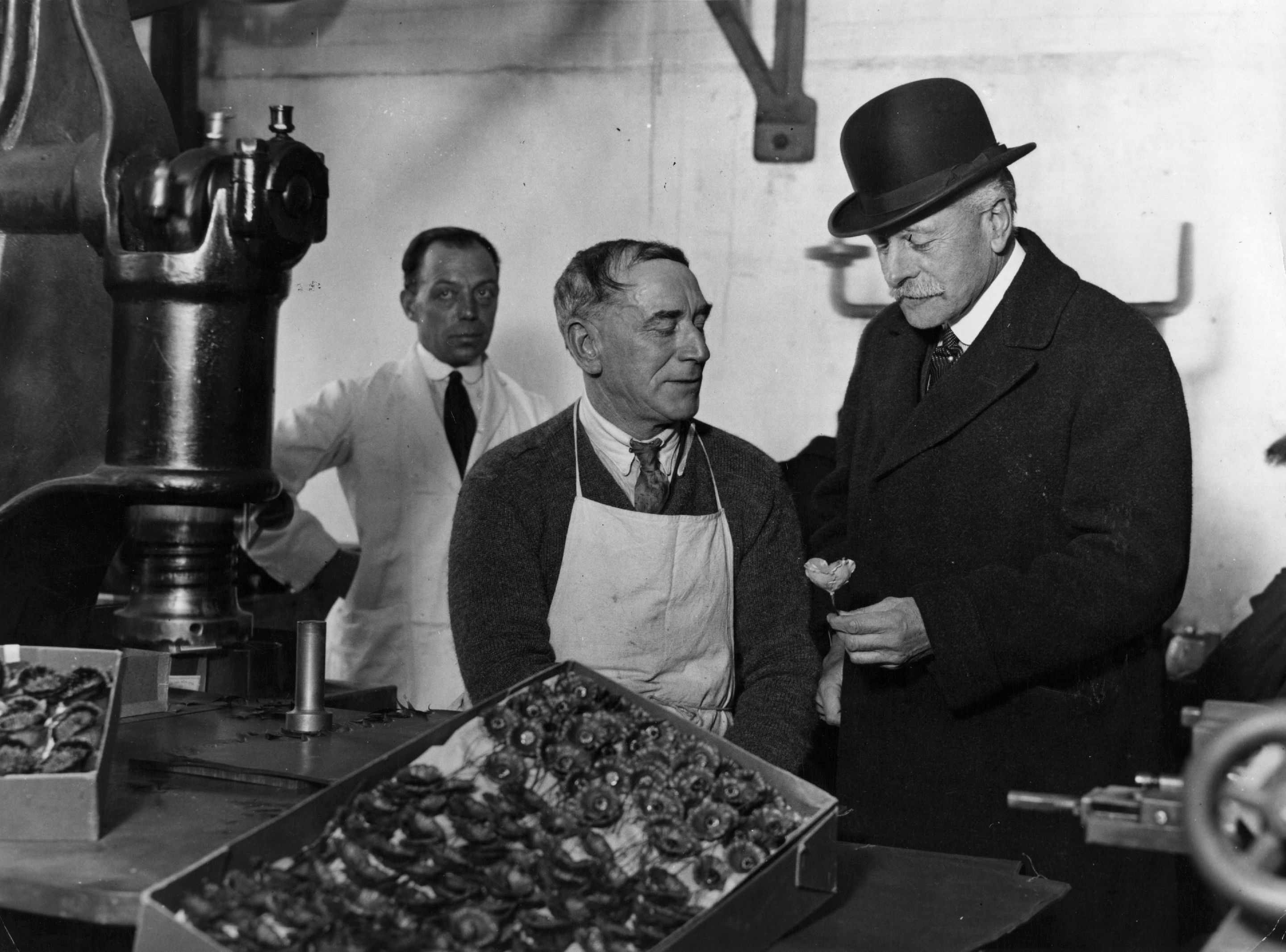 Douglas Haig (right) watches the stamping of poppies by ex-servicemen, during a visit to the British Legion poppy factory in Richmond, 22 October 1926. (Photo by Topical Press Agency/Getty Images)