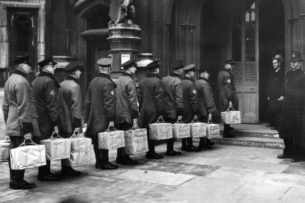 A second petition of 800,000 signatures, protesting against the abolition of the basic petrol ration, being presented to the House of Commons, 10 December 1947. (Photo by Harry Todd/Fox Photos/Getty Images)