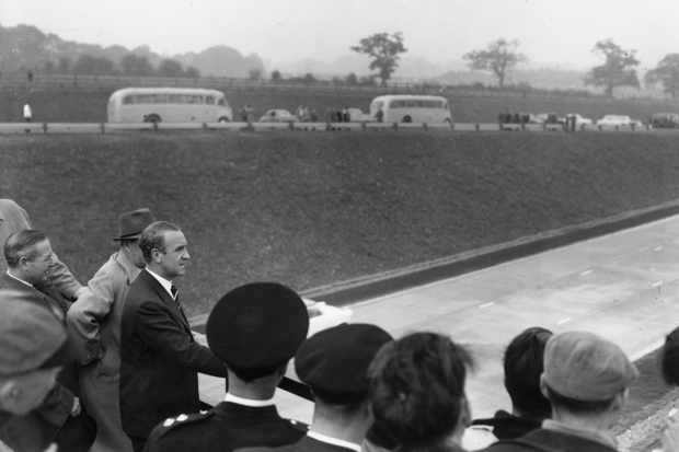 Transport minister Ernest Marples on a road bridge near the London end of the newly opened M1 motorway, 2 November 1959. (Photo by George W. Hales/Fox Photos/Getty Images)