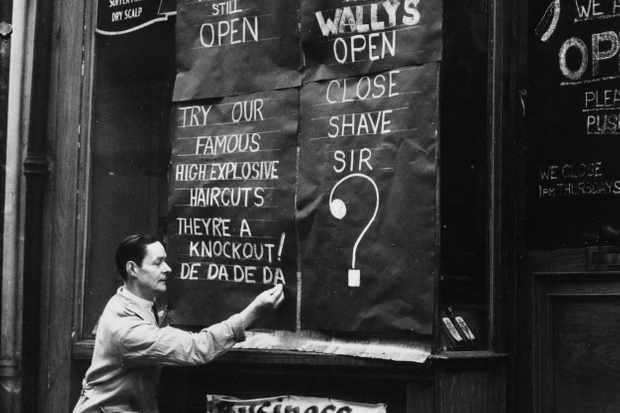 """Close shave sir?"" A windowless Wally's barber shop in St Martin's Street shows its defiance during the London Blitz, November 1940. (Fox Photos/Getty Images)"