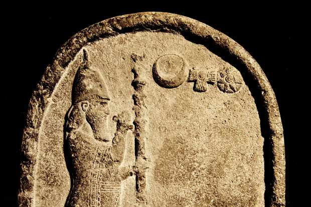 Made of basalt, this inscribed stone dates to the sixth century BC. The figure is Nabonidus who was the last king of Babylon before the Persian invasion under Cyrus II. (Photo by: Universal History Archive/UIG via Getty images)
