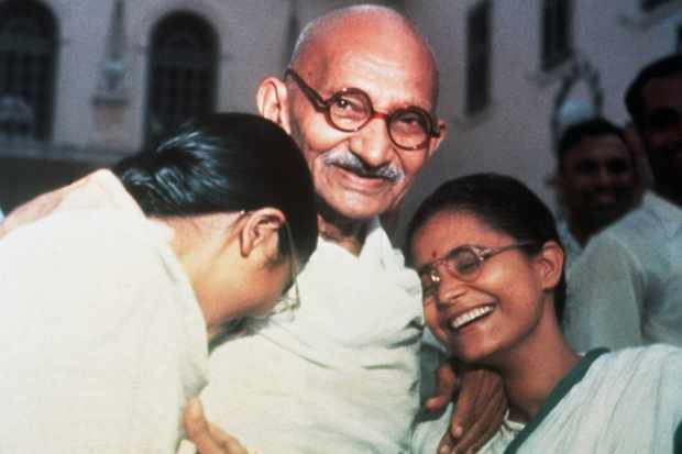 Mohandas Ghandi, 'the father of the nation', enjoys a laugh with his two granddaughters. (Photo by Bettmann via Getty Images)
