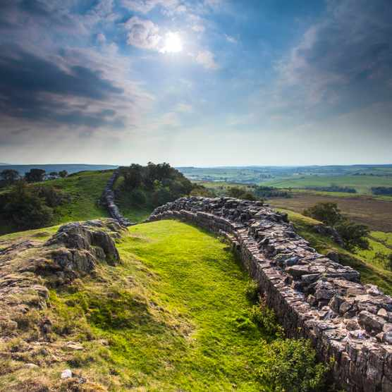 Hadrian's wall is a major attraction for tourists today, and was perhaps a sacred draw in Roman times. (Loop Images/UIG via Getty Images)