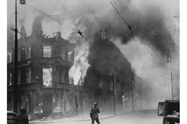 In 1943 the Warsaw Ghetto was burnt to the ground by Nazi troops and all its surviving inhabitants were sent to the concentration camp at Treblinka, and the Ghetto was blitzed to the ground. (Photo by © Hulton-Deutsch Collection/CORBIS/Corbis via Getty Images)
