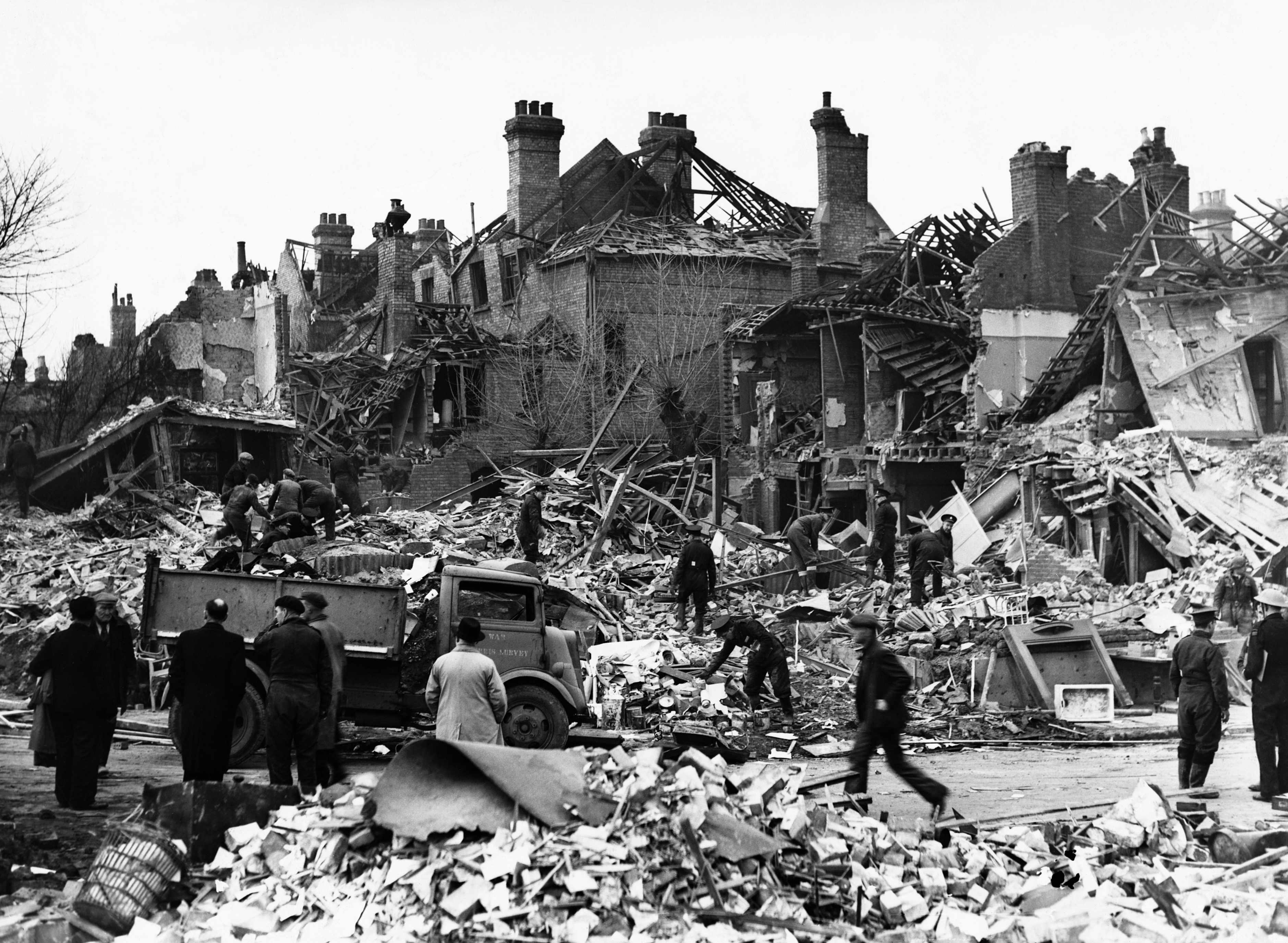 Clean-up crews salvaging what they can from the ruins of buildings in Hornsey, a north London suburb, 1944. (Photo by © Hulton-Deutsch Collection/CORBIS/Corbis via Getty Images)