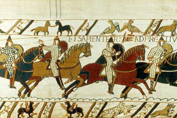 Norman cavalry charge the enemy in this detail from the Bayeux Tapestry. Debate rages over the pros and cons of the tapestry leaving France for the first time in more than 900 years. (Photo by Photo 12/Getty Images)