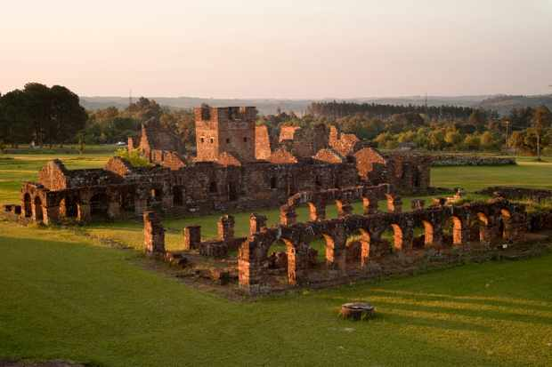 Evening light sweeps over the ruins of the Jesuit mission church at Trinidad de Paraná, Paraguay, where the bell tower of the site's first of two churches stands. Scores of Jesuit missions in the area where Paraguay, Argentina and Brazil meet were built in the 17th century and were abandoned when the Jesuits were expelled in the 18th century. (Photo by Kevin Moloney via Getty Images)