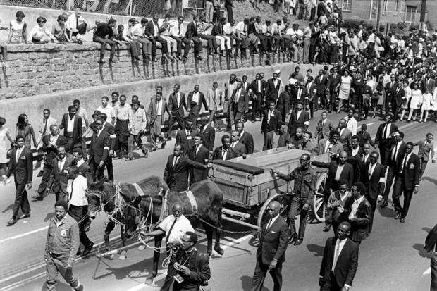 Mourners gather during Martin Luther King's funeral procession in Atlanta, Georgia, 1968. Rather than rely on a few isolated images, sentences, and moments from King's career, it is far better to understand the contradictions that Martin Luther King embodied in his life, says Benjamin Houston. (Photo by Ken Guthrie/Getty Images)