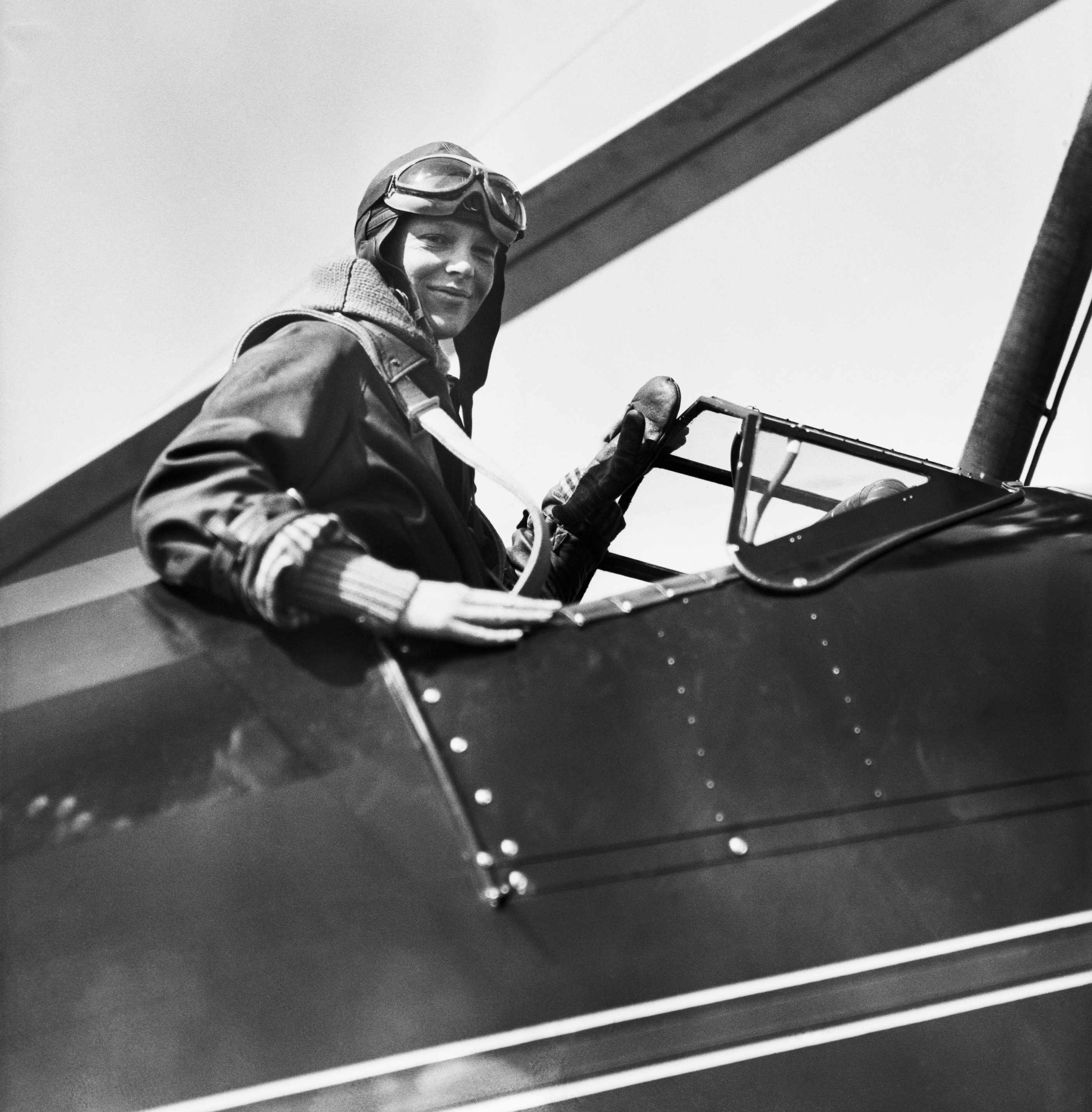 (Original Caption) 4/8/1931-Philadelphia, Pennsylvania-Amelia Earhart in the cockpit of her autogiro after setting a new altitude record for women in planes of this type. She failed, however, to break Elinor Smith's record of 27,418 feet in a non-windmill type plane.